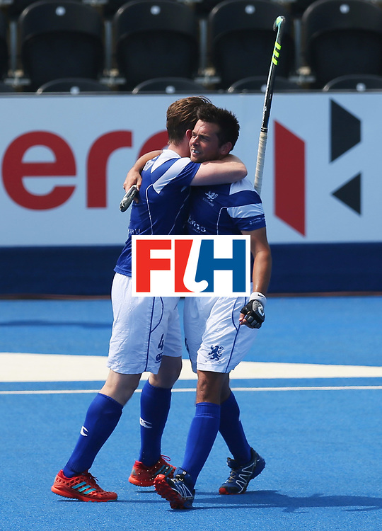 LONDON, ENGLAND - JUNE 20:  Willie Marshall of Scotland celebrates with David Forsyth (L) as he scores their first goal during the Pool B match between Scotland and Canada on day six of the Hero Hockey World League Semi-Final at Lee Valley Hockey and Tennis Centre on June 20, 2017 in London, England.  (Photo by Alex Morton/Getty Images)