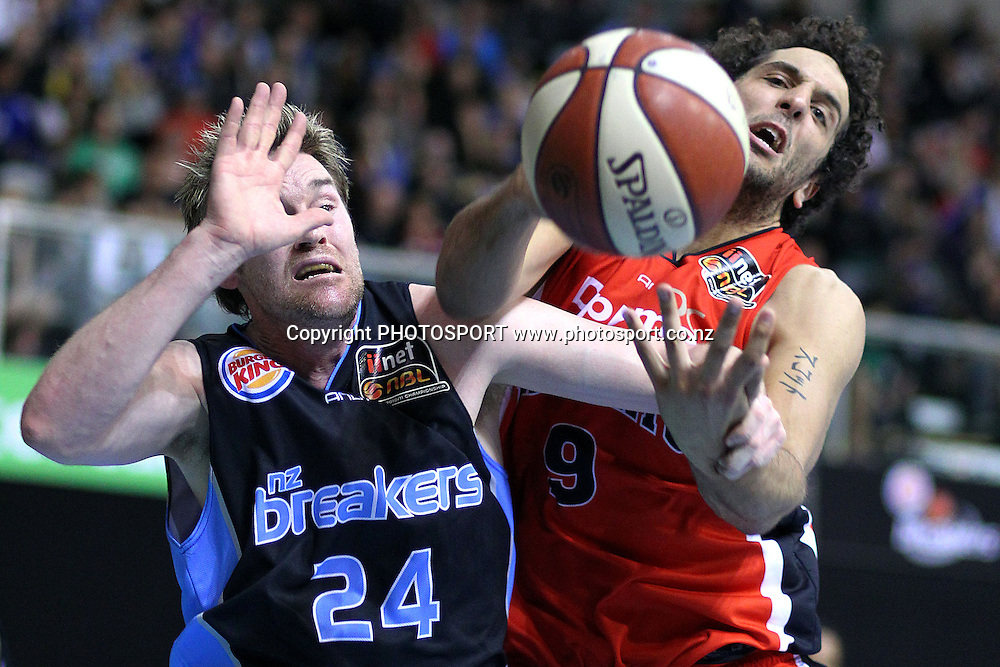 Breakers' Dillon Boucher battles against Wildcats' Matthew Knight for the ball. iinet ANBL, New Zealand Breakers vs Perth Wildcats, North Shore Events Centre, Auckland, New Zealand. Wednesday 20th October 2010. Photo: Anthony Au-Yeung / photosport.co.nz