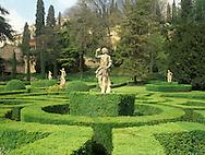 Stone statues and topiary in the Giardina Giusti<br /> Verona, Veneto, Italy