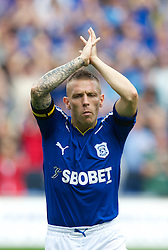 CARDIFF, ENGLAND - Saturday, August 21, 2010: Cardiff City's Craig Bellamy prepares to face Doncaster Rovers on his debut during the Football League Championship match at the Cardiff City Stadium. (Pic by: David Rawcliffe/Propaganda)