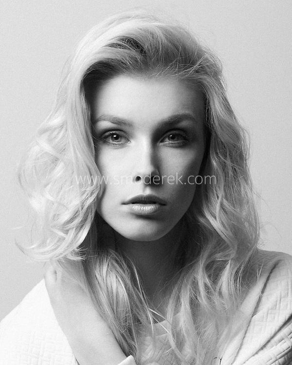 Black and white headshot of a female model (Specto Models).