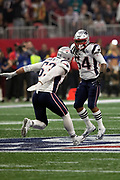 New England Patriots outside linebacker Dont'a Hightower (54) leaps in the air as he celebrates with New England Patriots middle linebacker Kyle Van Noy (53) after sacking the quarterback for a third quarter loss of 9 yards at the Patriots 35 yard line on a third down play during the NFL Super Bowl 53 football game against the Los Angeles Rams on Sunday, Feb. 3, 2019, in Atlanta. The Patriots defeated the Rams 13-3. (©Paul Anthony Spinelli)