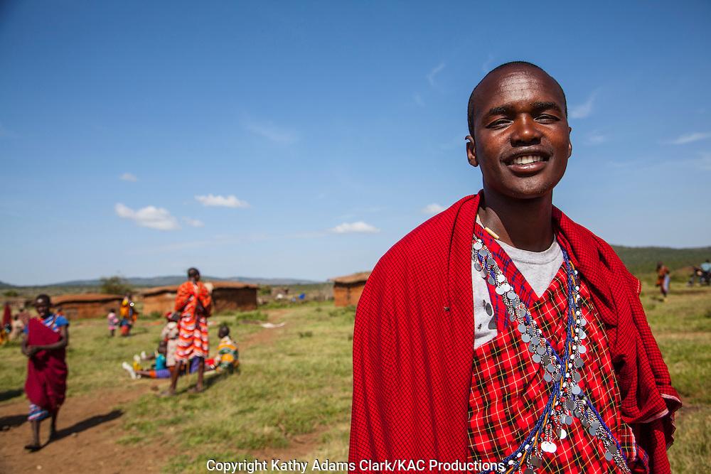 Maasai man in native costume, colorful dress, at a village outside, Serengeti National Park, Tanzania, Africa.