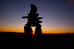 "The Inukshuk, meaning ""image of man"" is a lifelike figure of stone which was erected by the Inuit people and are unique to the Canadian Arctic. They act as a compass or guide through the wilderness for a safe journey and represent safety, trust and reassurance, Northwest Territory, Canada"