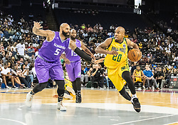 July 6, 2018 - Oakland, CA, U.S. - OAKLAND, CA - JULY 06: Andre Owens (20) of the Ball Hogs drives past Carlos Boozer (5) co-captain of Ghost Ballers during game 2 in week three of the BIG3 3-on-3 basketball league on Friday, July 6, 2018 at the Oracle Arena in Oakland, CA (Photo by Douglas Stringer/Icon Sportswire) (Credit Image: © Douglas Stringer/Icon SMI via ZUMA Press)