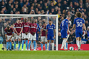 Chelsea midfielder Ross Barkley (8) and Chelsea defender David Luiz (30) eye up the free-kick after the foul on Chelsea midfielder Eden Hazard (10) (not in picture) during the Premier League match between Chelsea and West Ham United at Stamford Bridge, London, England on 8 April 2019.