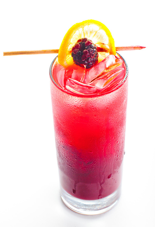 Blackberry Bourbon Leomonade with fresh-pressed lemon juice, Benchmark bourbon. organic blackberry and cardamon, topped with sparkling wine -- at Yardbird in Miami Beach