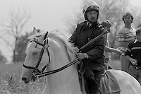 Mounted Policeman with drawn long baton after charging miners pickets at Orgreave. 30 May 1984.