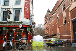 © Licensed to London News Pictures. 03/03/2019. London, UK. Police tent outside The Coach and Horses pub in Romilly Street in Soho. According to the police, a man aged 30 yrs old is seriously injured in hospital and a woman has been arrested. Photo credit: Dinendra Haria/LNP