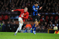 Wayne Rooney of Manchester United shoots during the UEFA Champions League First Knockout Round Second Leg match between Manchester United and Inter Milan at Old Trafford on March 11 2009, in Manchester, England.