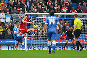 Middlesbrough FC defender Daniel Ayala blocks a shot from Brighton striker, Tomer Hemed (10) during the Sky Bet Championship match between Brighton and Hove Albion and Middlesbrough at the American Express Community Stadium, Brighton and Hove, England on 19 December 2015. Photo by Phil Duncan.