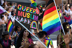 "© Licensed to London News Pictures . 24/08/2019. Manchester, UK. "" Queer Muslim Babe "" placard . The 2019 Manchester Gay Pride parade through the city centre , with a Space and Science Fiction theme . Manchester's Gay Pride festival , which is the largest of its type in Europe , celebrates LGBTQ+ life . Photo credit: Joel Goodman/LNP"
