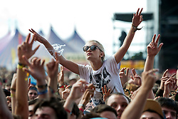 © London News Pictures. 25/08/2012. Reading, UK. Revelers watching 'Odd Future' perform on the main stage on day two of Reading Festival 2012 in Reading, Berkshire, UK on August 25, 2012. The three day event which attracts over 80,000 music fans headlines The Cure, Kasabian and The Foo Fighters Photo credit : Ben Cawthra/LNP
