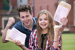 © Licensed to London News Pictures. 14/08/2014. Solihull, West Midlands, UK. A level results announced at Solihull School earlier today. Magnificent seven, Lauren Buchan and Tom Griesbach, both 18, seven A stars between them. Photo credit : Dave Warren/LNP