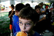 Danny Lambert, 10,  slups a snow cone while learning about everything from earthworms to bio deisel at the Energy Fair at Ohio University on Tuesday, October 5, 2005.