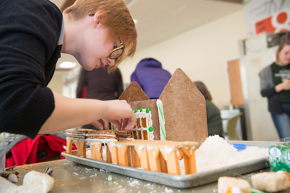 Elana Harnish helps contruct the office of Global Affairs' entry into this year's gingerbread decoration competition. Photo by Ben Siegel
