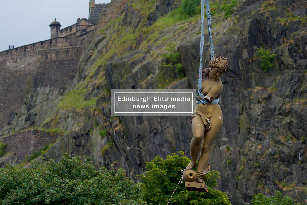 The statue at the top of The Ross Fountain in West Princes Street Gardens has today been lifted off marking the start of the £1.5M renovation by The Ross Development Trust. The two tonne statue was removed by a 15m crane in an operation that lasted around an hour. The statue will now undergo a careful renovation before being returned to Edinburgh in the Autumn.2017, (c) Brian Anderson   Edinburgh Elite media. Thursday 6th July, 2017