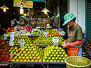 10 JULY 2018 - NAKHON PATHOM, THAILAND:  A woman sells oranges in the market in Nakhon Pathom. Nakhon Pathom is about 35 miles west of Bangkok. It is one of the oldest cities in Thailand, archeological evidence suggests there was a settlement on the site of present Nakhon Pathom in the 6th century CE, centuries before the Siamese empires existed. The city is widely considered the first Buddhist community in Thailand and the nearly 400 foot tall Phra Pathom Chedi is considered the first Buddhist temple in Thailand.    PHOTO BY JACK KURTZ