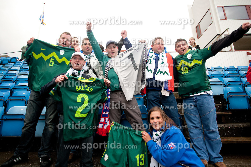 Fans of Slovenia celebrates with Jerseys of Slovenian players after the EURO 2012 Qualifications football game between Faroe Islands and Slovenia, on June 3, 2011 in Stadium Svangaskard, Toftir, Faroe Islands.  Slovenia defeated Faroe Islands 2-0. (Photo By Vid Ponikvar / Sportida.com)