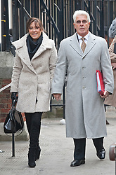 © Licensed to London News Pictures. 09/02/2012. London, UK. publicist Max Clifford arriving at the Royal Courts of Justice on February 9th, 2012   with his wife Jo to give evidence at the Leveson Inquiry in to press standards.. Photo credit : Ben Cawthra/LNP