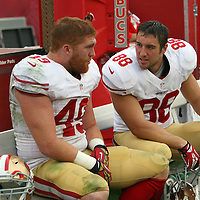 San Francisco 49ers fullback Bruce Miller (49) and San Francisco 49ers tight end Garrett Celek (88) during an NFL football game between the San Francisco 49ers  and the Tampa Bay Buccaneers on Sunday, December 15, 2013 at Raymond James Stadium in Tampa, Florida.. (Photo/Alex Menendez)