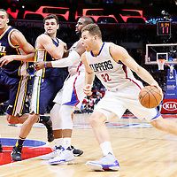 25 November 2015: Los Angeles Clippers forward Blake Griffin (32) drives past Utah Jazz guard Raul Neto (25) and Utah Jazz center Rudy Gobert (27) on a screen set by Los Angeles Clippers guard Chris Paul (3) during the Utah Jazz 102-91 victory over the Los Angeles Clippers, at the Staples Center, Los Angeles, California, USA.