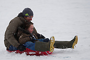 Scenery in Seaford, East Sussex on a snowy day in January 2013 People tobogganing down Seaford Head