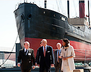 SS Robin, the worlds oldest complete streamship visited by HRH Prince Philip the Honorary Member of the SS Robin trust, who will be 93 on June 10th 2013. Photograph by Brian Harris, London, England. 5-6-2013<br /> Prince Philip only a few days short of his 93rd birthday paid a visit to the SS Robin at the launch of 'Open Doors' the final phase of a 5 year &pound;3 Million restoration project masterminded by David and Nish Kampfnerseen here in white on right. the SS Robin is berthed at London Victoria docks for final fitting out.<br /> SS Robin is a 300-tonne steam coaster, a class of steamship licensed only for passage in coastal waters, the oldest complete example in the world, situated at the Royal Docks in London, England for restoration and later display from 2014.<br /> <br /> SS Robin is one of three ships in London on the Core Collection of the National Historic Ships Register (the nautical equivalent of a Grade 1 Listed Building); the others are Cutty Sark and HMS Belfast. One of a pair of 'coasters' built in Bow Creek in 1890, the ship was originally intended to carry raw materials and the products of British industry around the UK and northern Europe.<br /> SS Robin was built in 1890 by Thames Ironworks and Shipbuilding and Engineering Company Ltd. of Orchard House Yard, Bow Creek. She is a steam vessel built for coastal trade, and was built in a style that had been used since the 1840s; similar ships were in constant use up to the 1940s.SS Robin was launched on 16 September 1890, and after being fitted out in East India Docks was towed to Dundee to have the engine and auxiliary machinery fitted. On 20 December 1890, Robin commenced her career in the British coastal service at Liverpool, with a crew of 12 signing the Articles for her maiden voyage.<br /> Press Release.<br /> His Royal Highness The Duke of Edinburgh is to visit the world's oldest complete steamship on June 5th, forty years after he started the campaign to save her for the nation.   Prince Philip will unveil a plaque to inaugurate SS Robi