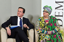 Leader of the Conservative Party David Cameron gives a speech at Demos with Frank Field Labour MP for Birkenhead and (R)Camila Batmanghelidjh, Founder and Director of Kids Company, London, Monday January 11, 2010. Photo By Andrew Parsons / i-Images.