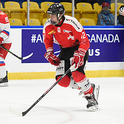 WHITBY, - Dec 15, 2015 -  WJAC Game 6- Team Russia vs Team Switzerland at the 2015 World Junior A Challenge at the Iroquois Park Recreation Complex, ON. Lee Roberts #12 of Team Switzerland skates up the ice during the second period.<br /> (Photo: Andy Corneau / OJHL Images)