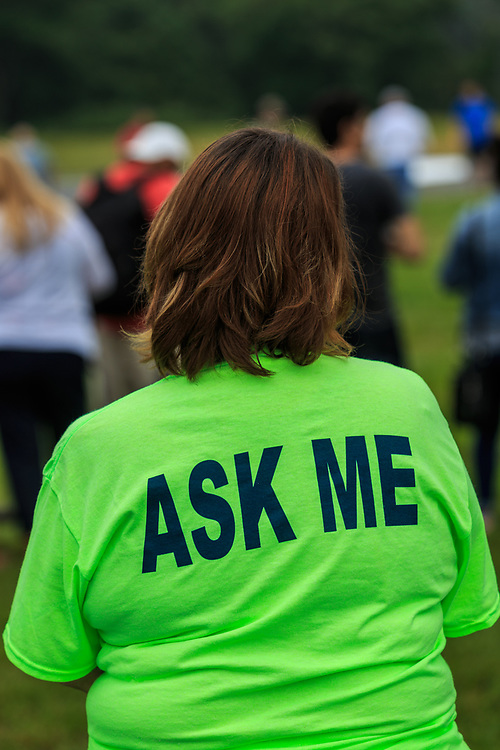 """Avondale, PA, USA - June 24, 2018: A volunteer wears an """"Ask Me"""" shirt at the annual Chester County Balloon Festival at the New Garden Flying Field in Toughkenamon."""