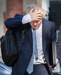 © Licensed to London News Pictures. 23/07/2019. London, UK.  Conservative Party Leadership contender Boris Johnson passes a demonstrator as he arrives in Westminster. The result of the Conservative party leadership contest will be announced today. Photo credit: Peter Macdiarmid/LNP