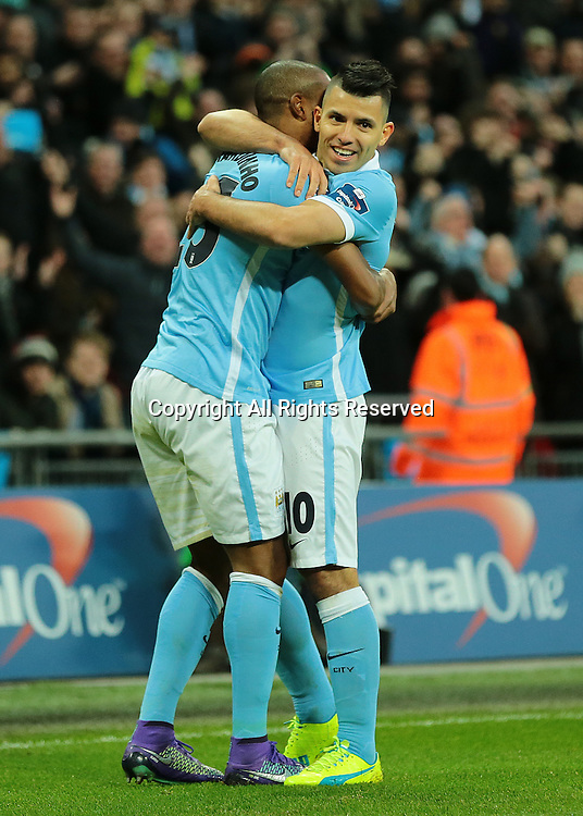 28.02.2016. Wembley Stadium, London, England. Capital One Cup Final. Manchester City versus Liverpool. Manchester City Forward Sergio Agüero celebrates with Manchester City Midfielder scorer Fernandinho, 1-0 Manchester City