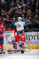 KELOWNA, CANADA - MARCH 7: Tate Coughlin #18 of Kelowna Rockets celebrates a goal against Tyson Verhelst #31 of Spokane Chiefs on March 7, 2015 at Prospera Place in Kelowna, British Columbia, Canada.  (Photo by Marissa Baecker/Shoot the Breeze)  *** Local Caption *** Tate Coughlin; Tyson Verhelst;