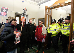 © under licence to London News Pictures 30/11/2010 Birmingham students marched to Birmingham Council House and entered the building earlier today. It is believed 30 students forced their way into the Council House. Picture shows students protesting in the reception area of the Council House as Police block their way..Picture credit: Dave Warren/London News Pictures...