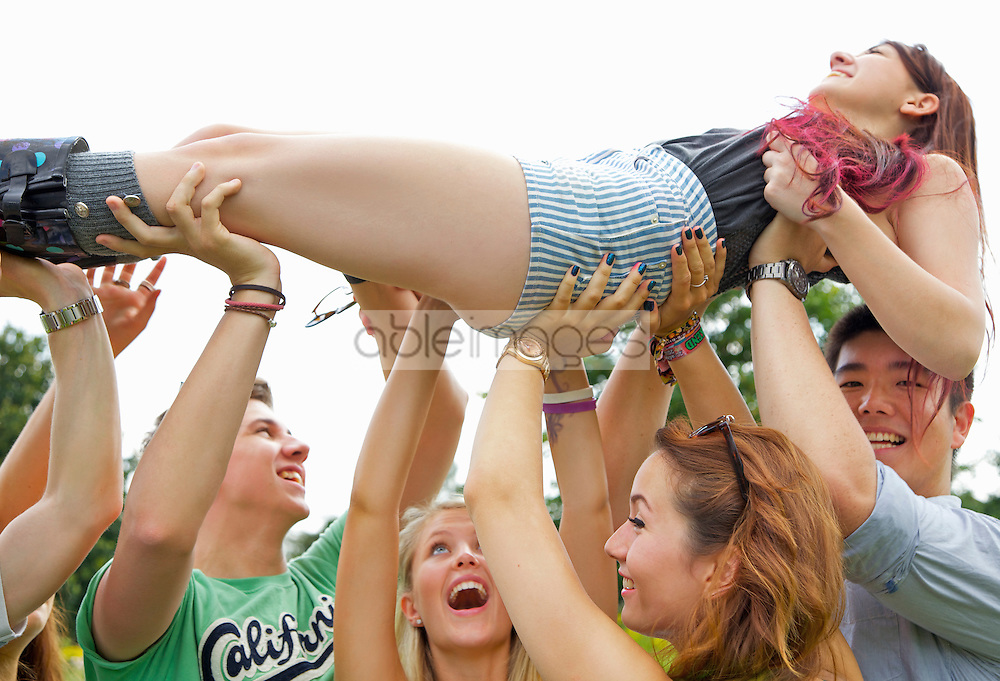 Teenagers Crowd Surfing at Music Festival