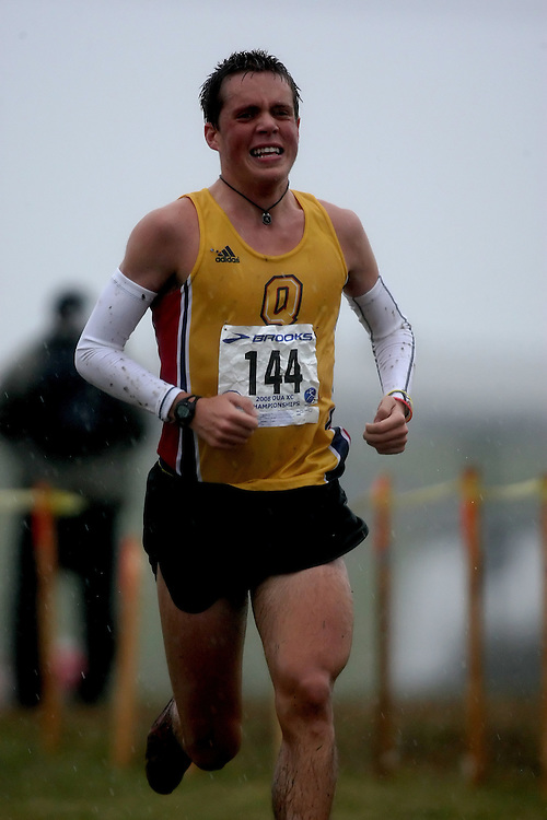 (Kingston, ON---25 October 2008) Trevor Walmsley of QUEEN'S University running to finish 37 in the 2008 Ontario University Athletics men's cross country championship.  Photograph copyright Sean Burges/Mundo Sport Images (www.msievents.com).