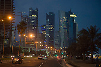 """10 APR 2013, DOHA/QATAR<br /> Qatar Downtown: Palm Towers (2. u. 4. v. links), Tornado Tower (3. v.L.) Al Bidda Tower (5. v.L.), Qatar World Trade Center (Qatar General Insurance Reinsurance Company) (2.v.R.), und Doha Tower, auch """"Condom Tower"""" (halb verdeckt rechts), gesehen von der Al Corniche Street<br /> IMAGE: 20130410-01<br /> KEYWORDS: Katar, Hochaus, Wolkenkratzer, Tower, Skyscraper, Nacht, Nachtaufnahme, Abend, Abendaufnahme, nachts, abends, night, Hochhaeuser, Hochäuser, Skyscraper, West Bay"""