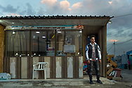 17 year-old Revan Manar Behnam has been running the shop with his father and his uncle for one year. They fled their home city of Qaraqosh because of the Islamic State's advance in August, 2014, but they don't live in the refugees camp. Back in Qaraqosh his father used to work as a driver.