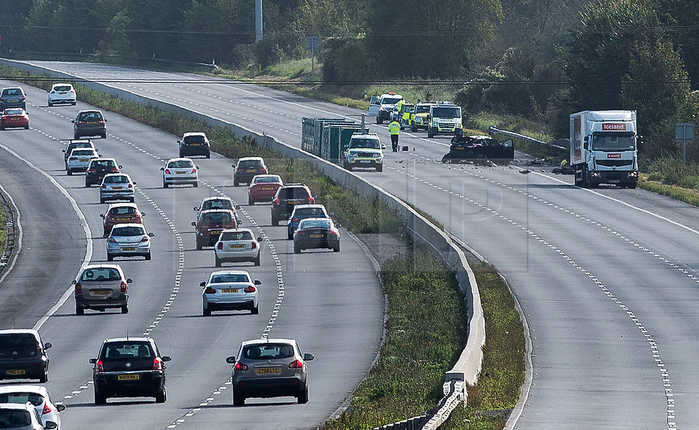 © Licensed to London News Pictures.  30/09/2017; Wiltshire, UK. Scene of crash between a lorry and a car which closed the M4 westbound in Wiltshire. Two people have bene killed in the incident at 05:00 BST near junction 17 at Leigh Delamere. Highways England is reporting that the M4 westbound between J17 (Chippenham) and J18 (Bath) will be closed until at least 4.30pm. A separate accident at junction 15 near Marlborough has also closed two lanes and diversions are in place. Picture credit : Simon Chapman/LNP