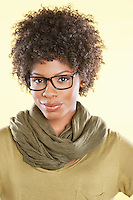 Portrait of an African American woman wearing glasses over colored background