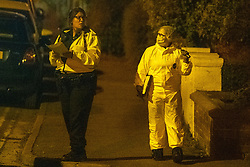 © Licensed to London News Pictures. 22/07/2020. Thame, UK. A forensic investigator speaks to a uniformed officer on Chinnor Road in Thame. Thames Valley Police has launched a murder investigation in Thame. At approximately  19:05BST a man was found with injuries in Chinnor Road, Thame. The 20-year-old man was pronounced dead at the scene. Photo credit: Peter Manning/LNP