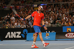 © Licensed to London News Pictures. 21/01/2012. Melbourne Park, Australia. Andy Murray (GBR) smashes a ball into the crowd after winning in his men's singles match against Michael Llodra (FRA) during the 6th day, round 3 of the Australian Open. Photo credit : Asanka Brendon Ratnayake/LNP