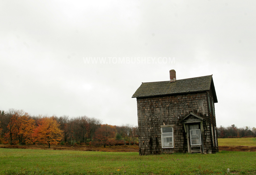 Bethel, N.Y. - A small house sits alone on a lot on Oct. 24, 2007.