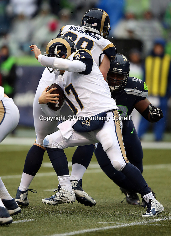 St. Louis Rams quarterback Case Keenum (17) runs the ball and gives the Rams a first down on a late hit by the Seattle Seahawks during the 2015 NFL week 16 regular season football game against the Seattle Seahawks on Sunday, Dec. 27, 2015 in Seattle. The Rams won the game 23-17. (©Paul Anthony Spinelli)