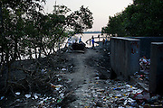 Indian tourists walk around the mangrove-lined coast on Gosaba island, Sundarban, West Bengal, India, on 18th January, 2012. The Sundarban islands and mangroves are sinking, say experts, due to climate change. Locals say they are overwhelmed by tourists' trash that affect the mangroves and sudden changes in weather patterns that have caused such damage that they continue to struggle to recover. One of the islands, once inhabited, has slowly sunk. Photo by Suzanne Lee for The National (online byline: Photo by Szu for The National)