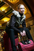 SHOT 11/27/2006 - A female model on a suitcase in the Brown Palace Hotel in Denver, Co..(Photo by MARC PISCOTTY)