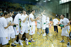 Mirza Sarajlija, Saso Ozbolt, Damjan Rudez, Vladimir Golubovic,  and Aleksej Nesovic (with champaign) Union Olimpija celebrates at third finals basketball match of Slovenian Men UPC League between KK Union Olimpija and KK Helios Domzale, on June 2, 2009, in Arena Tivoli, Ljubljana, Slovenia. Union Olimpija won 69:58 and became Slovenian National Champion for the season 2008/2009. (Photo by Vid Ponikvar / Sportida)