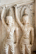 Guardian statues in the entrance passage to Lankatilake Temple. Kandy