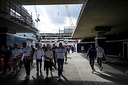 © Licensed to London News Pictures. 14/05/2017. London, UK. Fans walk through a section of the new stadium which is being built next to White Heart Lane, in North London where Tottenham Hotspur F.C. are playing their final game at the ground, against Manchester united today (Sun). Known as 'The Lane', Tottenham have been playing at the ground for 118 years, but will be playing at Wembley next season while a new 60,000 seat stadium is built for the start of the 2018/19 season.  Photo credit: Ben Cawthra/LNP